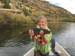 Young girl gets a big trout on the dry fly at the San Juan